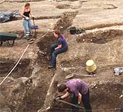 A group of archaeologists at the excavation site