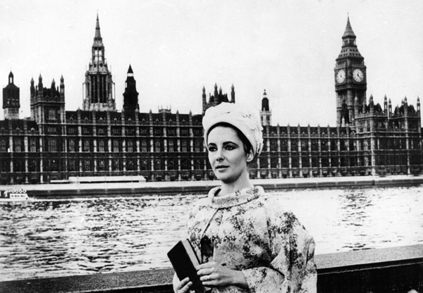 Elizabeth Taylor in front of the River Thames and Houses Of Parliament