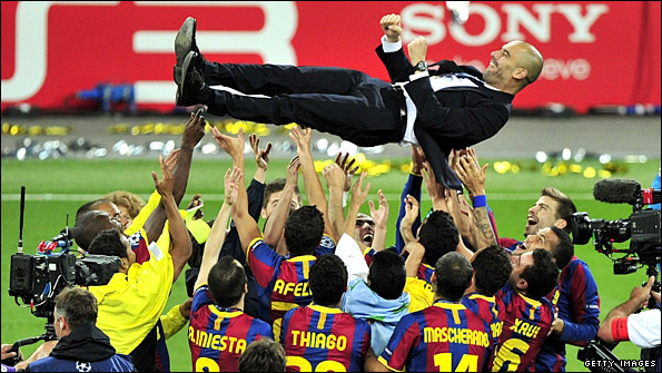 Pep Guardiola is launched into the air by the celebrating Barcelona players at Wembley