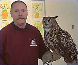 Image of a man with an owl