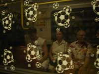 Even the glass on Berlin's underground is decked out with a football theme.