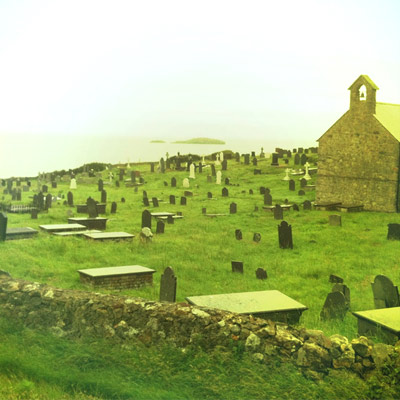 A view over the graveyard towards Middle Mouse island where Saint Patrick was once shipwrecked.