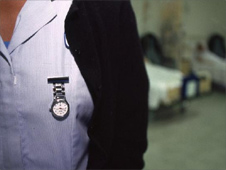 Nurse's watch on chest at Guys Hospital