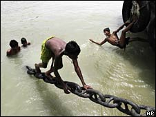 Boys play in the water in an effort to cool off in the river Ganges in Calcutta, India, Friday, May 14, 2010