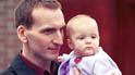 Joe (Christopher Eccleston) and baby Marie