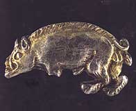 silver livery badge in the shape of a boar