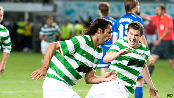 Georgios Samaras wheels away after firing Celtic to victory over Dinamo Moscow