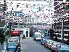 Photograph of a street decorated with bunting