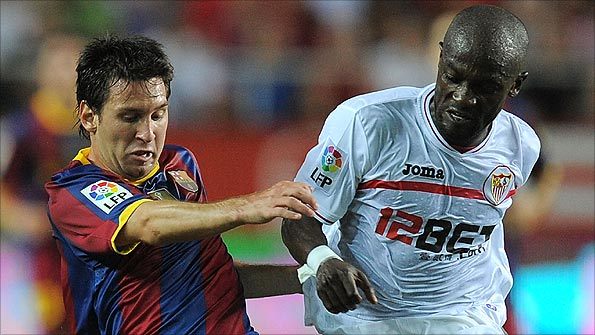 Zokora challenges Messi during a game in Seville in August. Photo: Getty Images