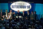 The Chief Electoral Officer announcing the result of the Northern Ireland referendum at the King's Hall, Belfast, 22 May 1998