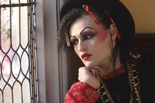 Douglas Booth as Boy George stares out of a window in Worried About The Boy