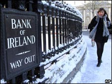 A woman walks past a branch of the Bank of Ireland in Central Dublin (28 Nov 2010)