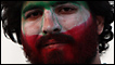 Man with an Iranian flag on his face