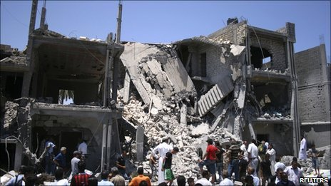 The rubble of a residential building in Tripoli which the Libyan authorities say was hit by a Nato air strike in June 2011