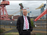Mike Adie in front of the Swan Hunter cranes