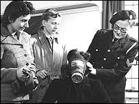 woman trying on gas mask