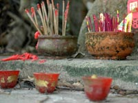 Many incense sticks standing in clay pots full of sand © iStockphoto/Christine Consalves