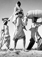 A group migrates to its new homeland after the partition of India in 1947