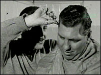 Striker Ernie Hunt cuts manager Bert Head's hair