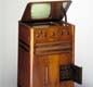 This television, unlike Baird's early disc models, uses the 'Cathovisor' (cathode ray tube display). It was launched in 1936 and was a luxury item sold for 85 guineas. At this time there were only about 20,000 television sets in Britain.