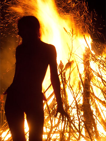 Performer silhouetted by fire