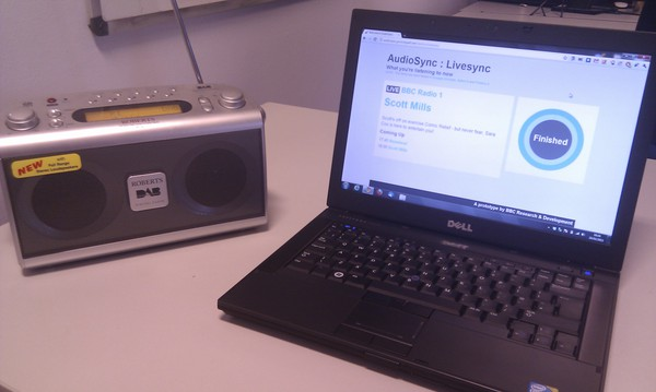 A photo of the AudioSync application running on a laptop next to a radio.