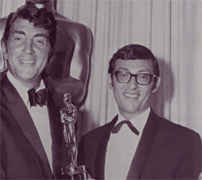 Don Black (right), pictured in 1966 receiving his Oscar from Dean Martin