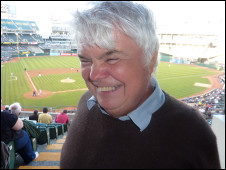Peter White recording Blind Man Roams the Globe at a baseball game in San Francisco, US