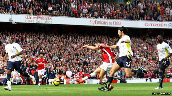 Cesc Fabregas scores Arsenal's second goal against Tottenham