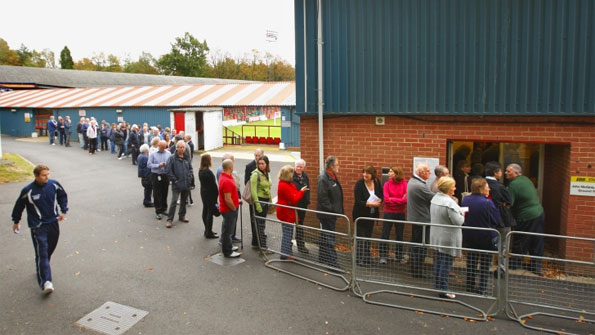Supporters queue for tickets to see the game against Manchester United.