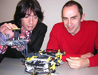 Laurence Llewellyn Bowen and Prof. Chris Wise with a walking building.