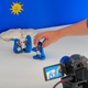 hand moving clay models in front of a camera