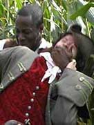 Historical reconstruction showing a black slave man attacking a white man