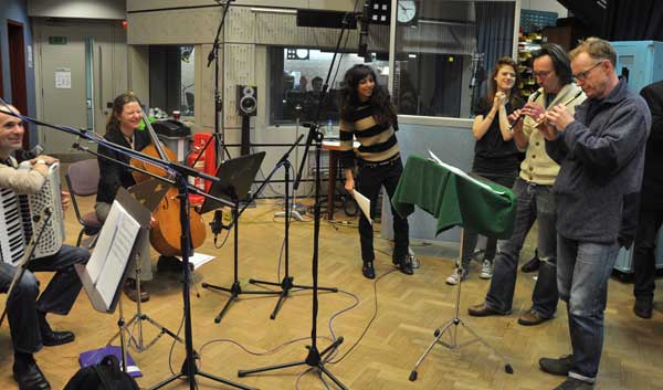 The cast and members of The Devil's Violin Company in the studio
