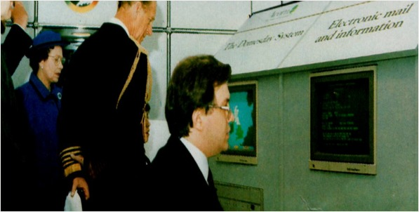 Ian Lauder demonstrates a Domesday Machine to the Queen and Prince Phillip.