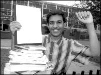 Babar Vaqaz celebrates after getting his GCSE results
