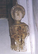 Image of a carved wooden angel on the wall at Kirtling parish church