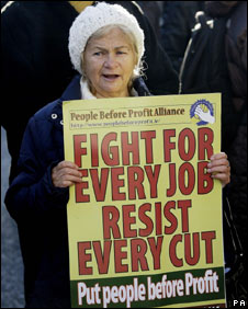 A woman protests against the cuts in Dublin, 24 November