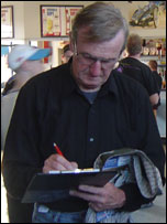 Man filling in the competition slip