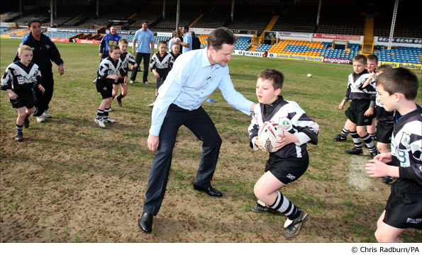 Nick Clegg plays tag rugby against the Leeds Rhinos under 10s during a visit to the club