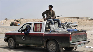 Libyan rebels wait at a checkpoint in Brega