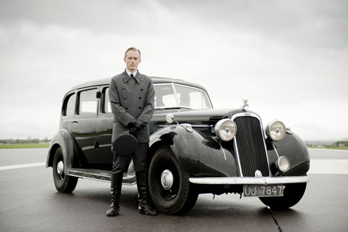 Harry Spargo (Neil Jackson) stands in front of one of the vintage cars sourced for Upstairs Downstairs