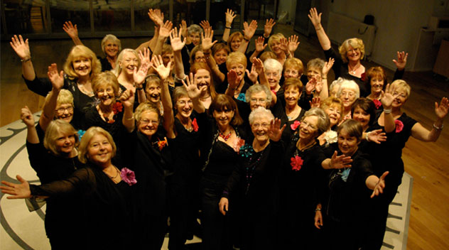 the ladies from the Fireflies Choir smiling in celebration of their grant