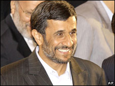 Iranian President Mahmoud Ahmadinejad, smiles during a summit of the Shanghai Cooperation Organization in the Ural Mountains city of Yekaterinburg, Russia, Tuesday, June 16, 2009