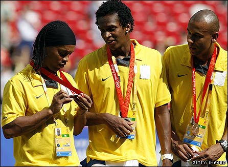 Ronaldinho inspects his bronze medal