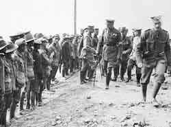 Kitchener passing Australian troops