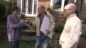Joe Swift showing the couple from Birmingham how to measure up their garden