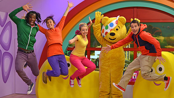 Sid, Kate, Cerrie, Pudsey and Alex jumping in the CBeebies studio.
