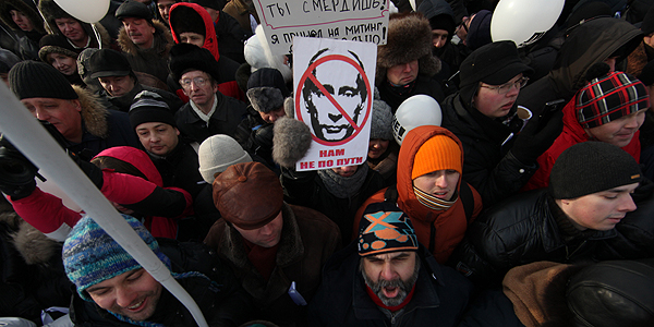 Russian oppostion activists take part in a rally and march to Bolotnaya Square on February 4, 2012 in Moscow, Russia.