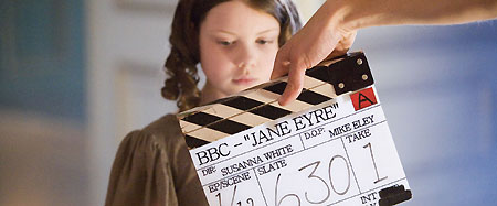 Young Jane (Georgie Henley) prepares for a take
